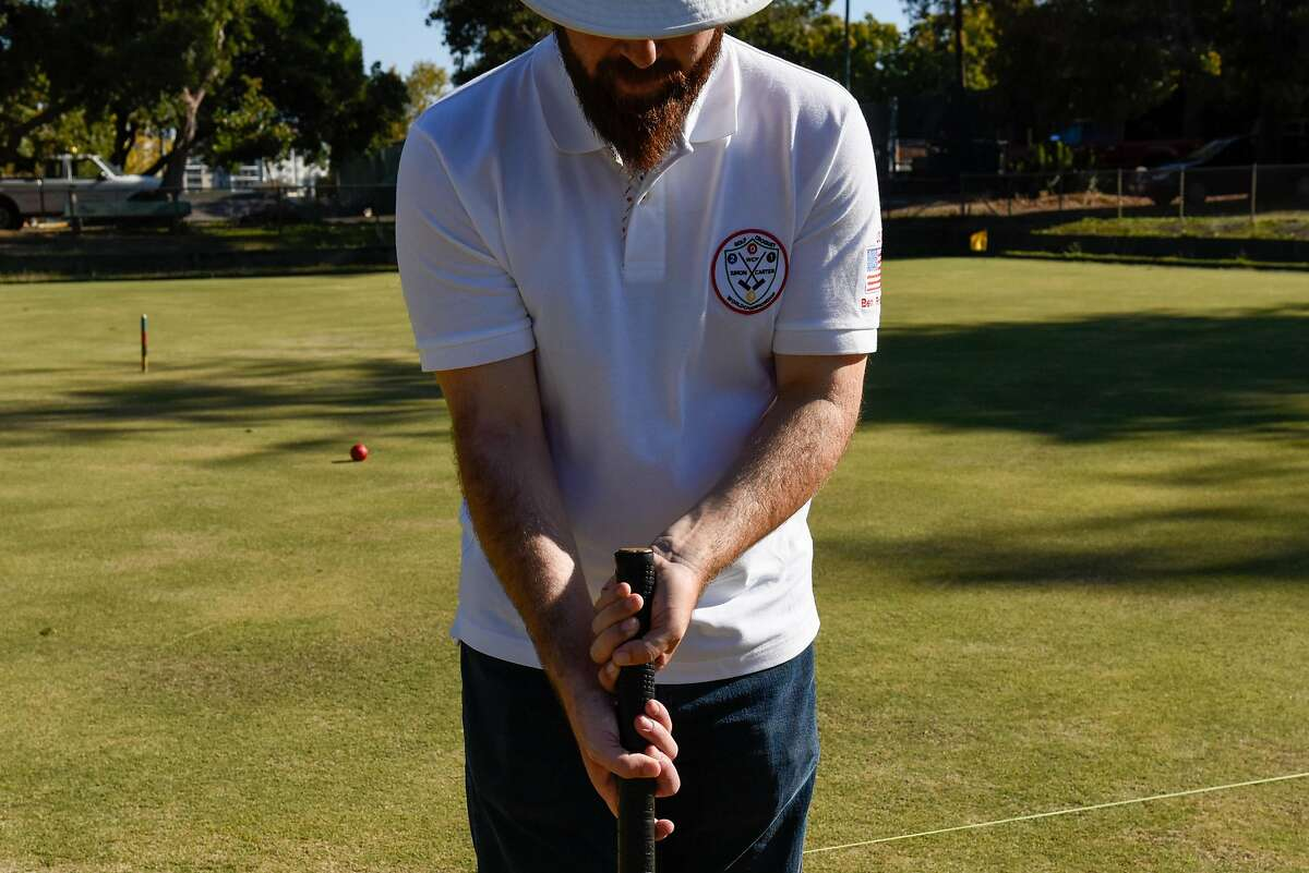 Ben Rothman, world champion of golf croquet, demonstrates different grips used to play golf croquet at the Oakland Croquet Club on October 17, 2019 in Oakland, Calif.