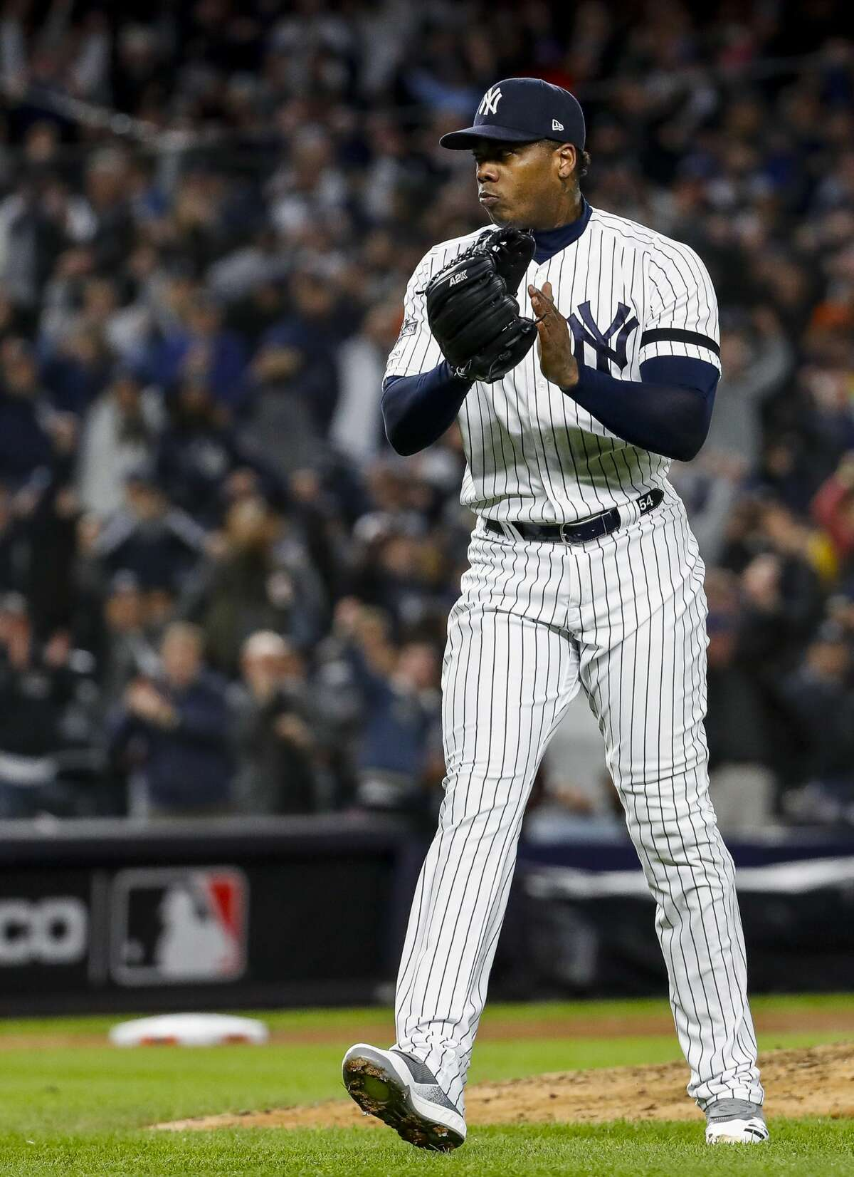 New York Yankees relief pitcher Aroldis Chapman (54) celebrates after getting the save and defeating the Houston Astros 4-1 in Game 5 of the American League Championship Series at Yankee Stadium on Friday, Oct. 18, 2019, in New York.