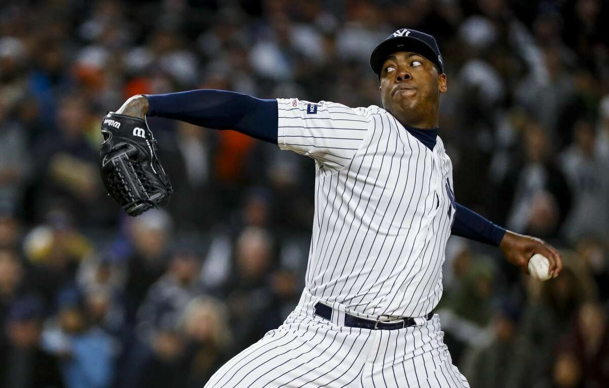New York Yankees relief pitcher Aroldis Chapman (54) throws the ball against the Houston Astros during the ninth inning of Game 5 of the American League Championship Series at Yankee Stadium on Friday, Oct. 18, 2019, in New York.