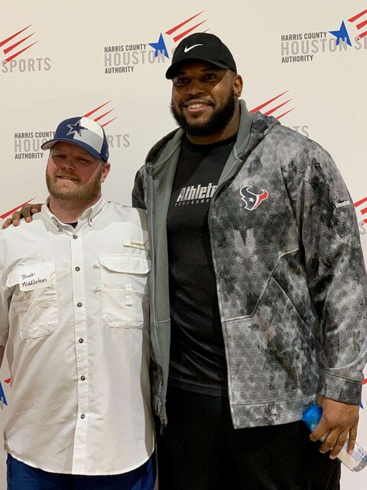 As they chatted, Brett Middleton (left), who lost his arm in a power line accident, and Anthony Hill discussed simple things people do each day and take for granted.