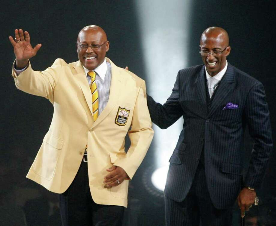 Floyd Little, left, and his presenter, son Marc Little, are introduced to the crowd at the Pro Football Hall of Fame Festival Enshrinees Dinner at the Canton Civic Center after Little received his gold blazer Friday, Aug. 6, 2010 in Canton, Ohio. Little will be inducted into the Pro Football Hall of Fame with six other former NFL greats Saturday. Photo: Scott Heckel