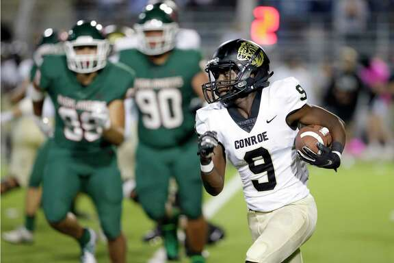 Conroe's Jalen Williams (9), pictured here as a junior against The Woodlands, will move from wide receiver to quarterback for his senior year.