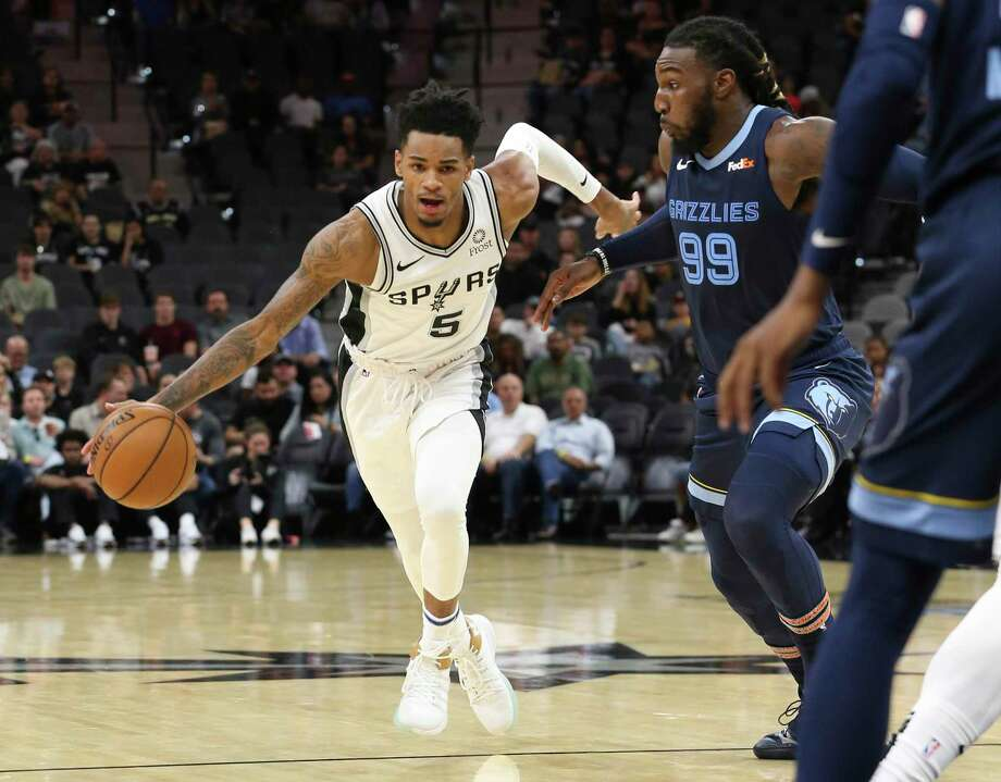 Spurs' Dejounte Murray (05) drives toward the basket against Memphis Grizzlies' Jae Crowder (99) in pre-season action at the AT&T Center on Friday, Oct. 18, 2019. (Kin Man Hui/San Antonio Express-News) Photo: Kin Man Hui, Staff / Staff Photographer / ©2019 San Antonio Express-News