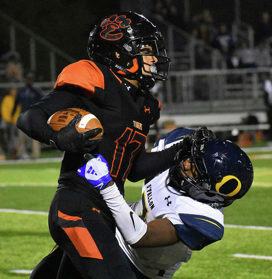 Edwardsville wide receiver Ethan Young delivers a stiff-arm to an O'Fallon defender after making a reception in the first quarter Friday. Photo: Matt Kamp|The Intelligencer