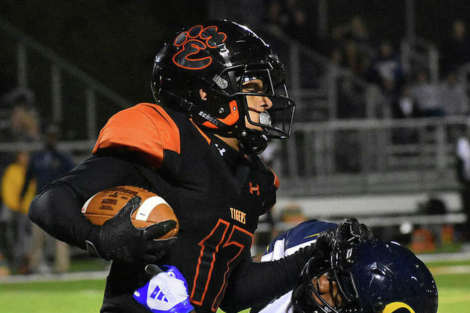 Edwardsville wide receiver Ethan Young delivers a stiff-arm to an O'Fallon defender after making a reception in the first quarter Friday.