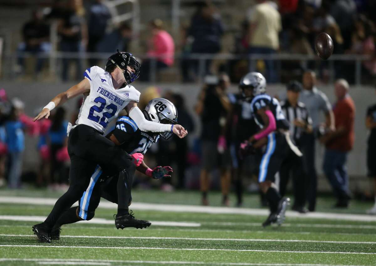 Friendswood 's Noah Smith (22) breaks up a pass intended for Shadow Creek's Jaylen Lane (26) in the first half on October 18 at Freedom Field in Rosharon, TX.