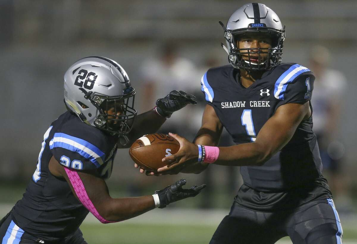 Shadow Creek's Kyron Drones (1) hands the ball of to Jay'Veon Bell (28) against Friendswood in the first half on October 18 at Freedom Field in Rosharon, TX.