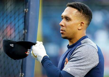 Houston Astros left fielder Michael Brantley (23) adjusts his cap during batting practice before Game 5 of the American League Championship Series at Yankee Stadium on Friday, Oct. 18, 2019, in New York.