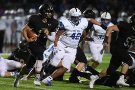 Vidor's Zach Seigrist runs the ball for a short gain against Barbers Hill at the Pirate's stadium Friday night. Photo taken Friday, 10/18/19