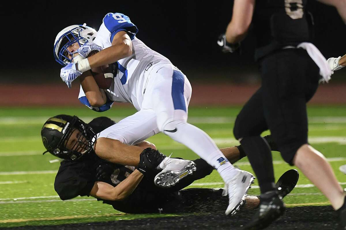 Vidor's Nathan Bullard blocks a Barbers Hill runner at the Pirate's stadium Friday night. Photo taken Friday, 10/18/19