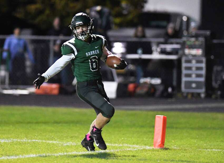 Schalmont's Ben Burchhard (6) runs with the ball for a touchdown against Holy Trinity during a Section II boys' high school football game in Rotterdam, N.Y., Friday, Oct. 18, 2019. (Hans Pennink / Special to the Times Union)