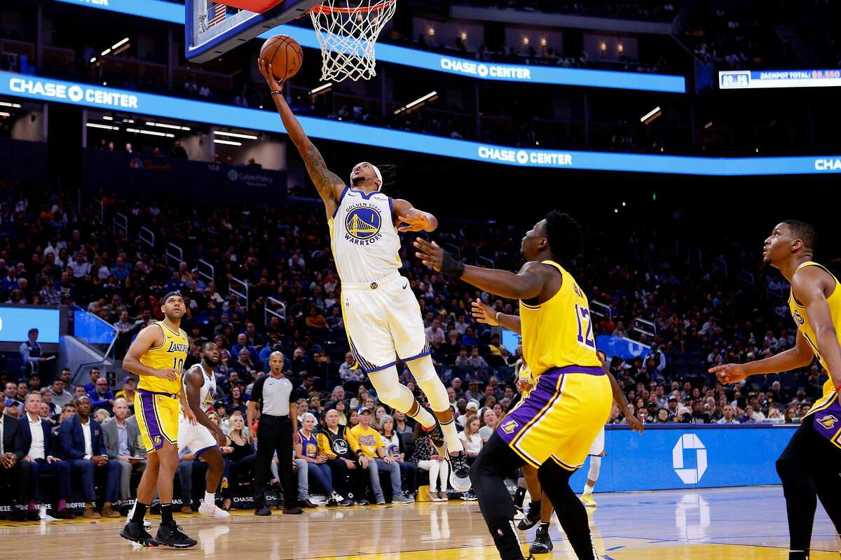 Golden State Warriors guard Damion Lee (1) scores against the Los Angeles Lakers during the first half of an NBA preseason game at Chase Center on Friday, Oct. 18, 2019, in San Francisco, Calif.
