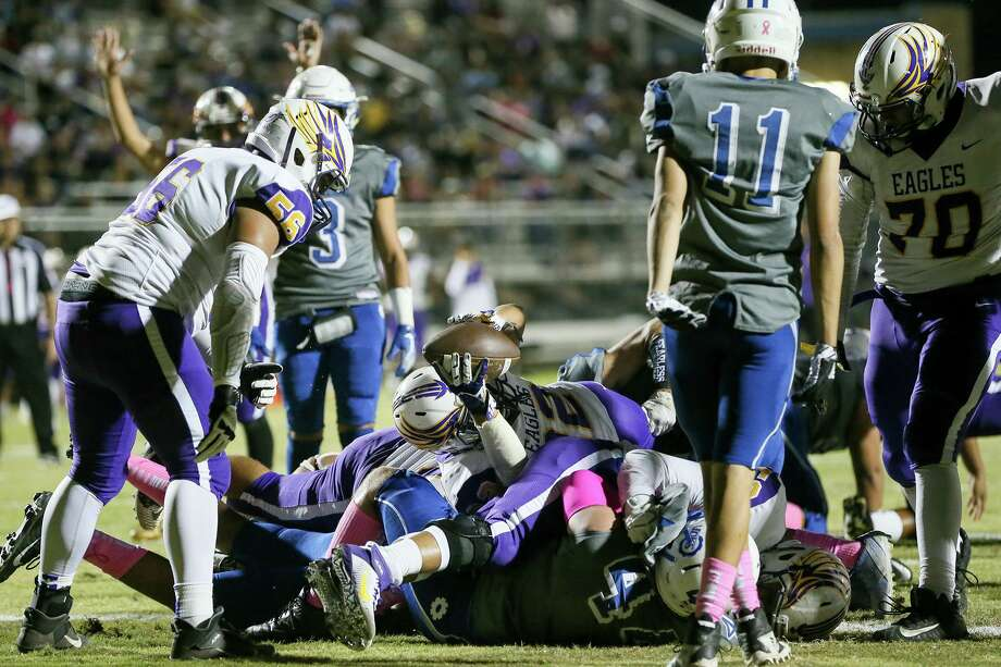 Brackenridge running back A.J. Alamantes, center, dives over the pile for a 3-yard touchdown in the first half in their District 13-5A-I high school football game with Lanier at SAISD Sports Complex on Friday, Oct. 18, 2019. Photo: Marvin Pfeiffer, Staff Photographer / Express-News 2019
