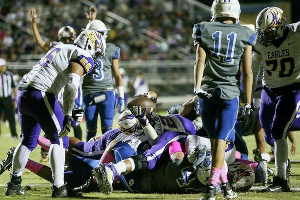 Brackenridge running back A.J. Alamantes, center, dives over the pile for a 3-yard touchdown in the first half in their District 13-5A-I high school football game with Lanier at SAISD Sports Complex on Friday, Oct. 18, 2019.