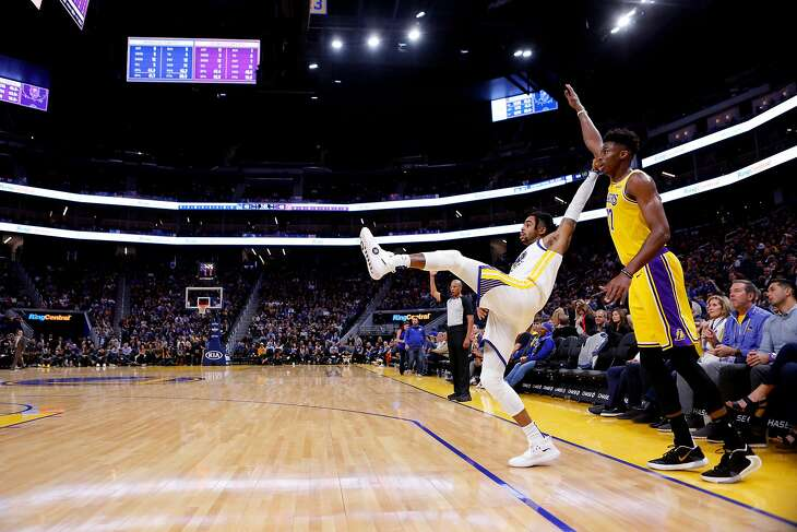 Golden State Warriors guard D'Angelo Russell (0) watches his attempt miss the net against Los Angeles Lakers forward Kostas Antetokounmpo (37) during the first half of an NBA preseason game at Chase Center on Friday, Oct. 18, 2019, in San Francisco, Calif.