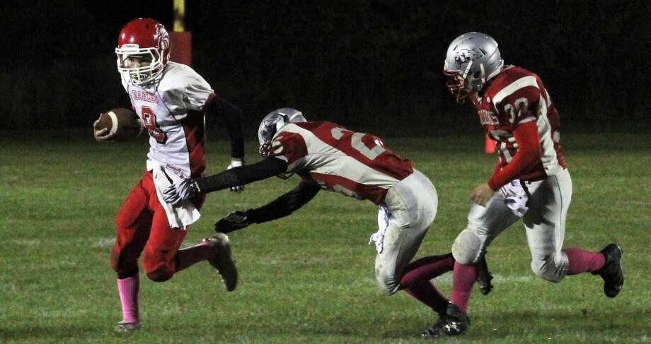 The Owen-Gage Bulldogs beat the Caseville Eagles, 58-30, in an offensive showcase on Friday night. Photo: Mark Birdsall/Huron Daily Tribune