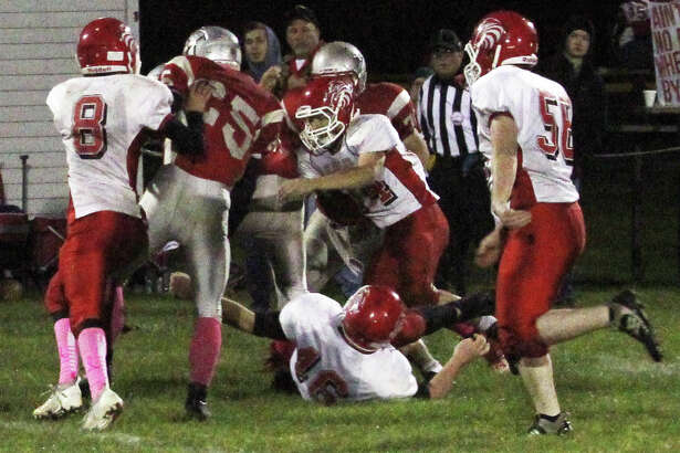 The Owen-Gage Bulldogs beat the Caseville Eagles, 58-30, in an offensive showcase on Friday night.