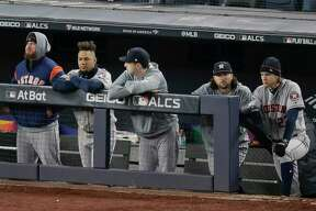 The Houston Astros watch play from the dugout during the ninth inning of Game 5 of baseball's American League Championship Series against the New York Yankees, Friday in New York.