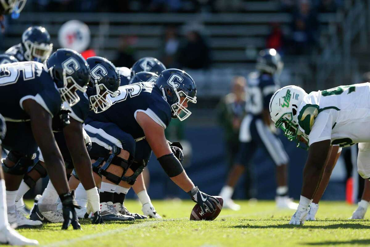 The Connecticut offensive line sets down against South Florida during the second half in East Hartford Oct. 5.