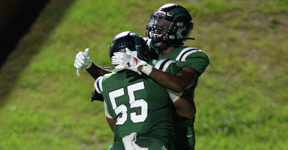 Donte Jones (1) and Curtis Stripling (55) of Mayde Creek celebrate a touchdown during the fourth quarter of a 6A Region III District 19 football game between the Taylor Mustangs and Mayde Creek Rams on Friday, October 18, 2019 at Rhodes Stadium, Katy, TX. Photo: Craig Moseley/Staff Photographer / ©2019 Houston Chronicle