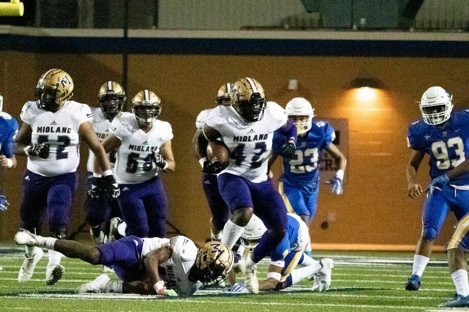 Midland High'€™s Jordan Springer escapes a tackle during the game against Frenship. Photo: AUDREY KERR