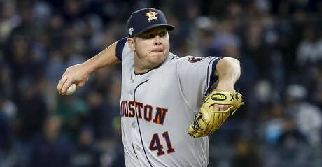 Houston Astros relief pitcher Brad Peacock (41) throws against New York Yankees during the eighth inning of Game 5 of the American League Championship Series at Yankee Stadium on Friday, Oct. 18, 2019, in New York.