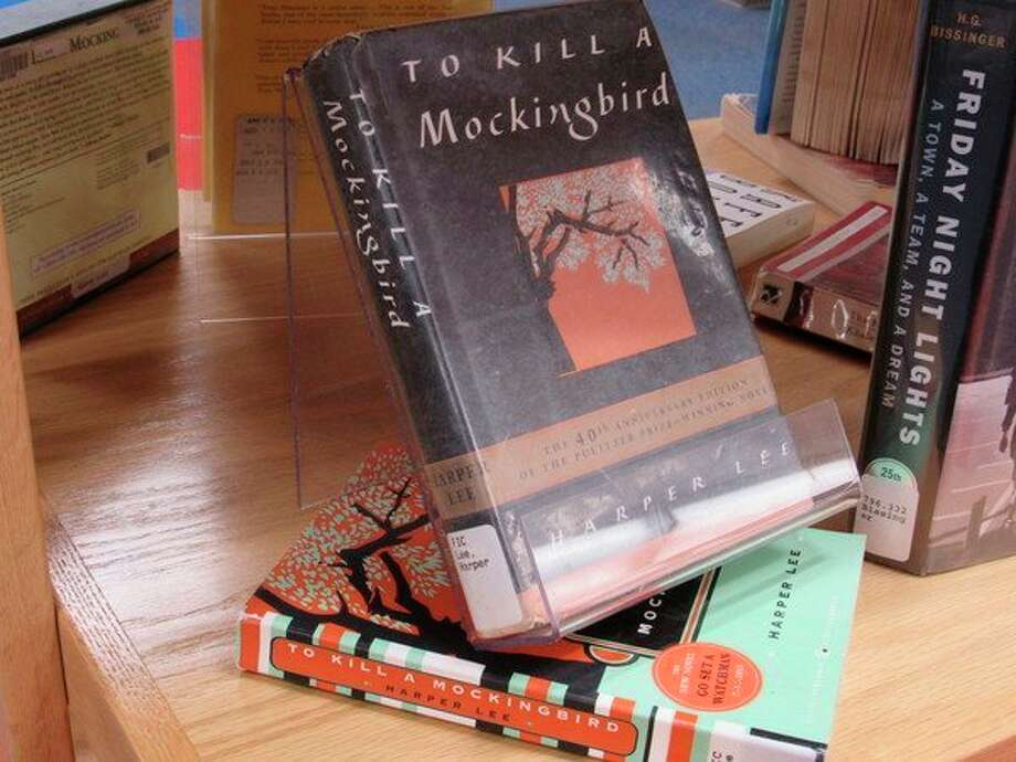 """A selection of challenged books sits on display at Grace A. Dow Memorial Library during Banned Books Week, Sept. 22-28. """"To Kill a Mockingbird"""" has beenchallengedin the past for violence, racism and racist language. """"Friday Night Lights"""" has beenchallenged for its sexual content, offensive language and racism. (Victoria Ritter/vritter@mdn.net)"""