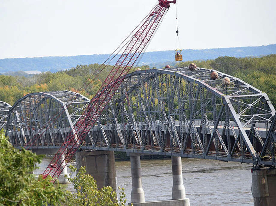 Scenes from the first implosion of the old Champ Clark Bridge Photo: Marco Cartolano | Journal-Courier