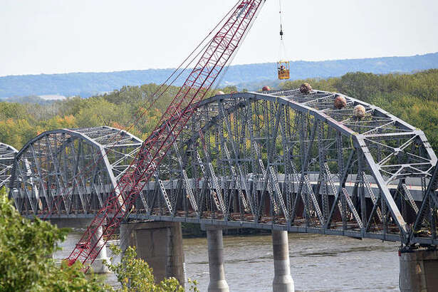 Scenes from the first implosion of the old Champ Clark Bridge