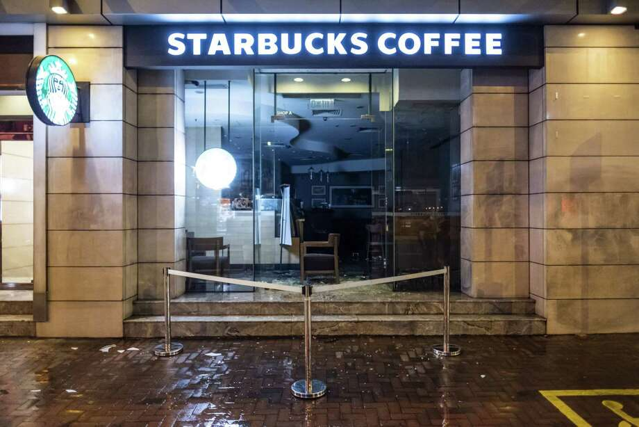A vandalized Starbucks Corp. coffee shop stands during a protest in Hong Kong on Oct. 4, 2019. Photo: Bloomberg Photo By Justin Chin. / © 2019 Bloomberg Finance LP