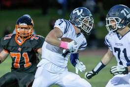 Mike Coffey gains yardage after making a catch in Friday's loss to Ridgefield.