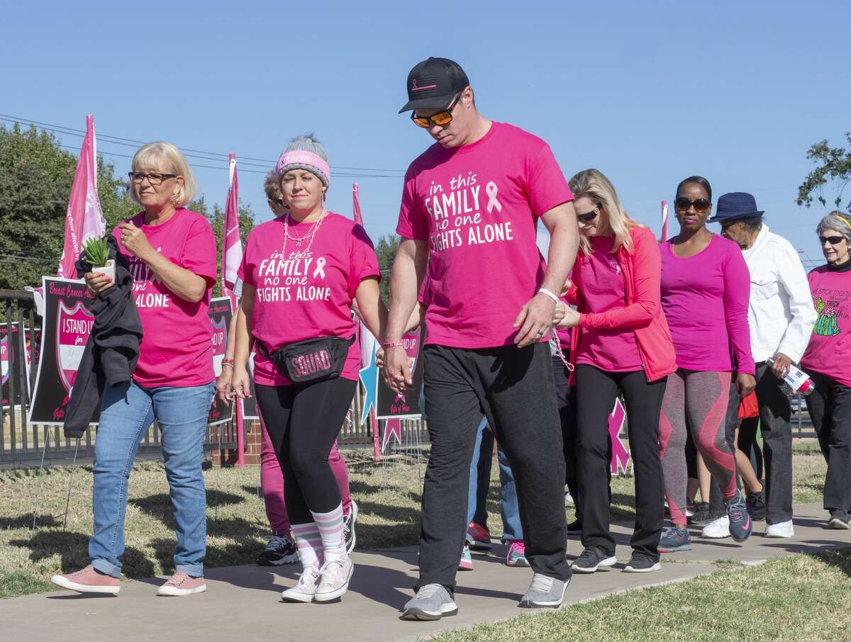Cancer survivors and their families begin the walk 10/19/19 during the annual Pink the Park Breast Cancer Awareness at Grafa Park. Tim Fischer/Reporter-Telegram