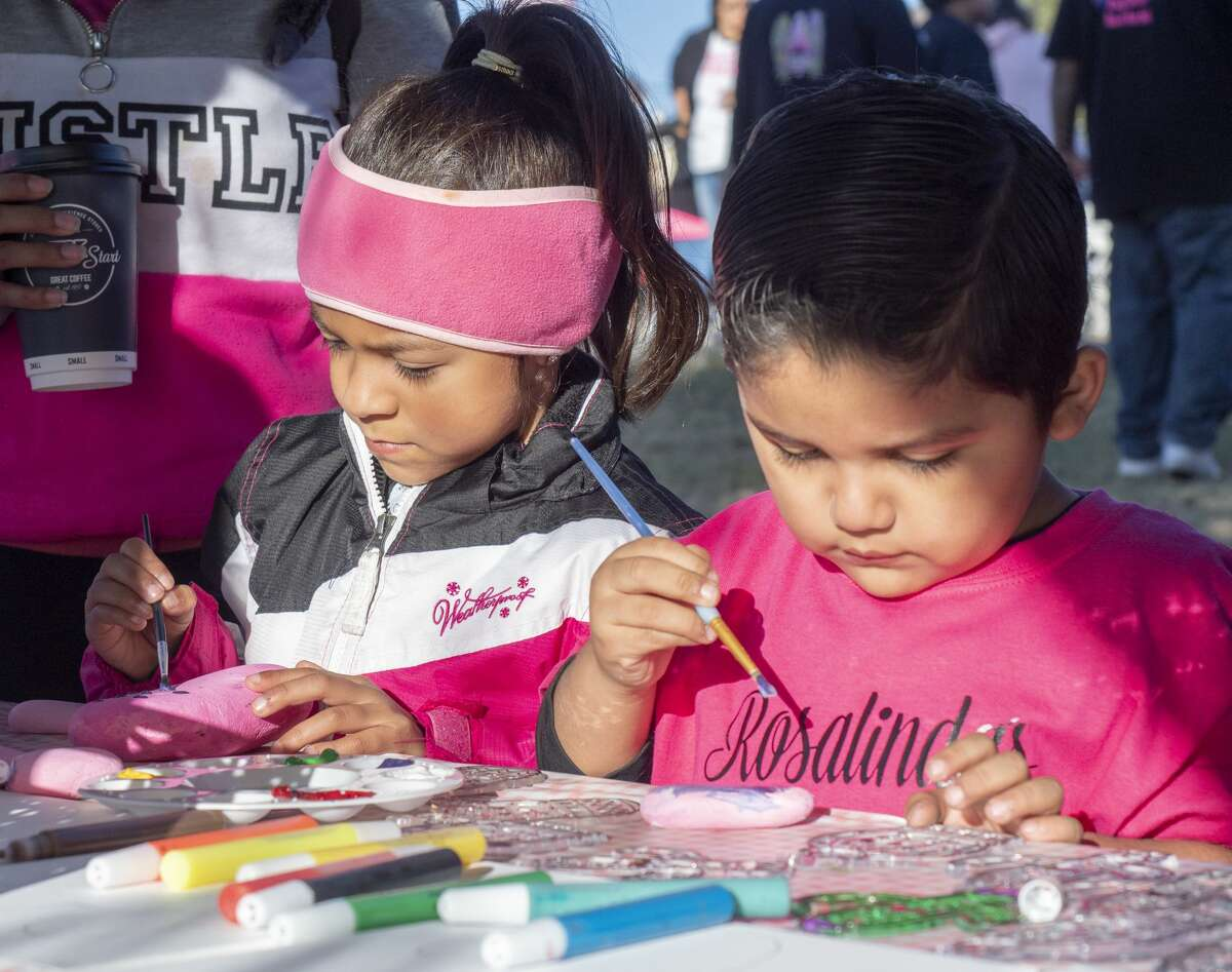 Lia Gamez and Angelo Cruz paint and decorate pink rocks 10/19/19 during the annual Pink the Park Breast Cancer Awareness at Grafa Park. Tim Fischer/Reporter-Telegram