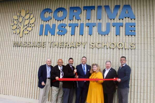 Cortiva Institute Massage Therapy Schools held a grand opening at 45 Shunpike Road in Cromwell Oct. 9. From left are Middlesex County Chamber of Commerce President Larry McHugh, Town Manager Tony Salvatore, Mayor Enzo Faienza, Regional Director of Operations, Cortiva, Kevin Beaver; School Director, Cortiva Institute, Elisabeth Johnson; Immediate Past Chamber Chairman Jay Polke, and Cromwell Division Chair Rodney Bitgood.