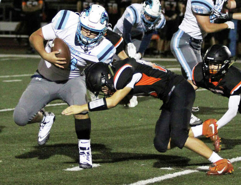 Jersey fullback Brian McDonald (left) scored a two-yard touchdown Friday night, but the Panthers went on to fall at Highland 42-21. Photo: Telegraph File Photo