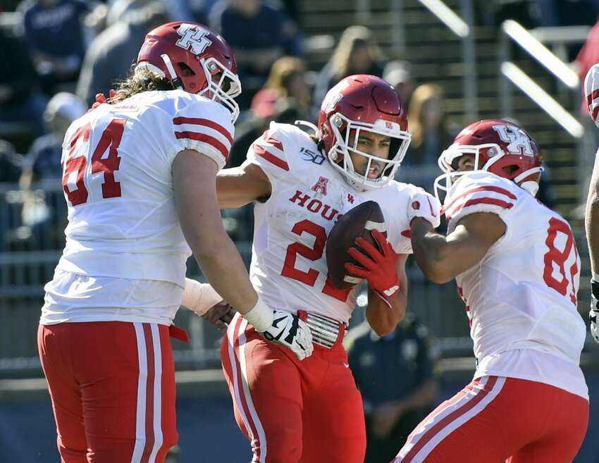 Houston running back Kyle Porter (22) celebrates after scoring during the first half of an NCAA college football game against Connecticut, Saturday, Oct. 19, 2019, in East Hartford, Conn. (AP Photo/Stephen Dunn)