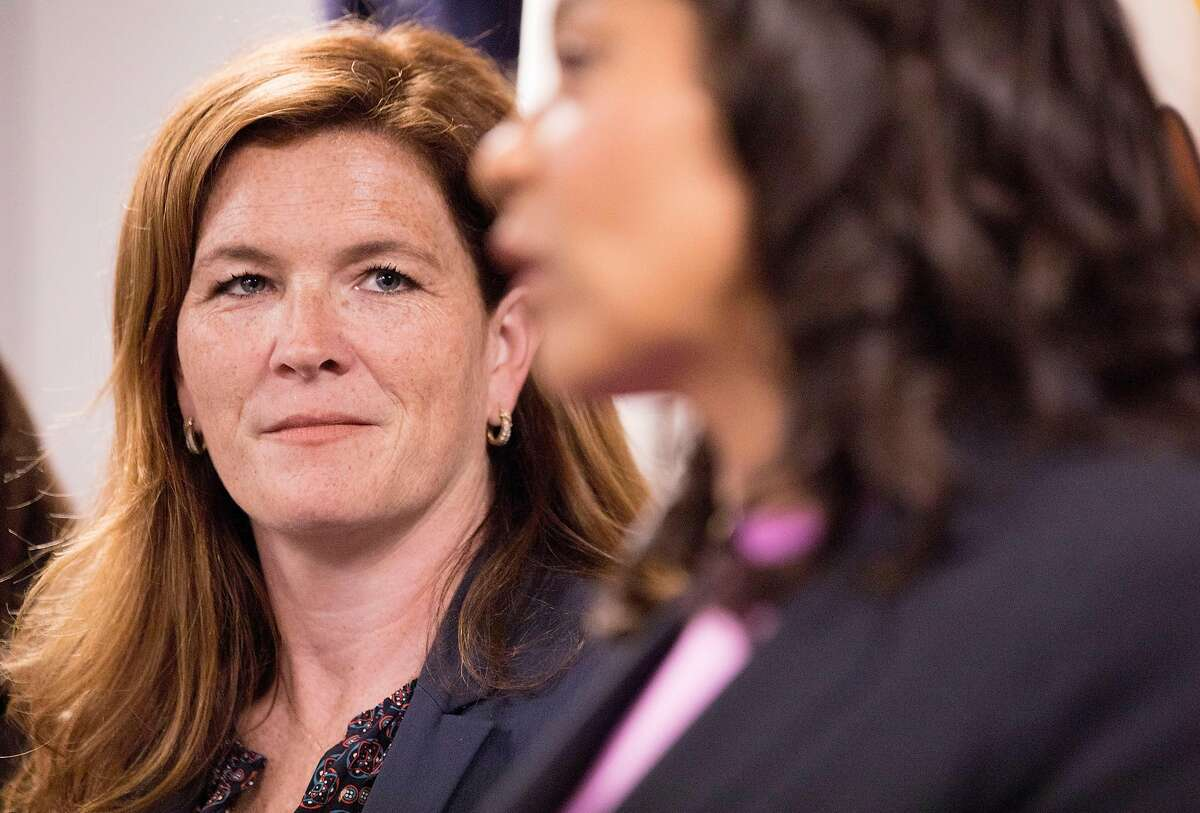 San Francisco District Attorney candidate Suzy Loftus looks Mayor London Breed before being sworn in as interim San Francisco District Attorney at the District Attorney's office in San Francisco, Calif. Saturday, Oct. 19, 2019.