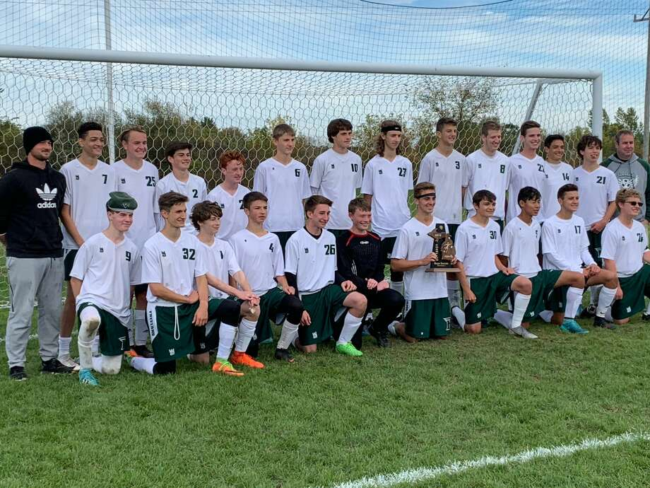 Freeland's soccer team poses with the district trophy after beating Bullock Creek 3-0 on Saturday. Photo: Fred Kelly/fred.kelly@mdn.net