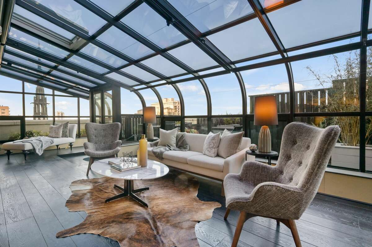High above Nob Hill, this $1.9M retro fabulous penthouse looks out at the city from a custom glass atrium and roof deck.