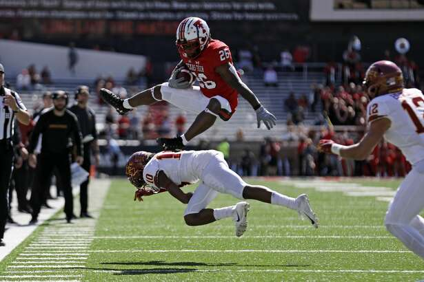 Texas Tech's Ta'Zhawn Henry (26) hurdles over Iowa State's Tayvonn Kyle (10) during the second half of an NCAA football game Saturday, Oct. 19, 2019, in Lubbock. (Brad Tollefson/Lubbock Avalanche-Journal via AP)
