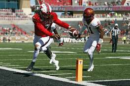 Texas Tech's Jett Duffey (7) stretches out trying to score a touchdown during the second half of an NCAA football game against Iowa State, Saturday, Oct. 19, 2019, in Lubbock. (Brad Tollefson/Lubbock Avalanche-Journal via AP)