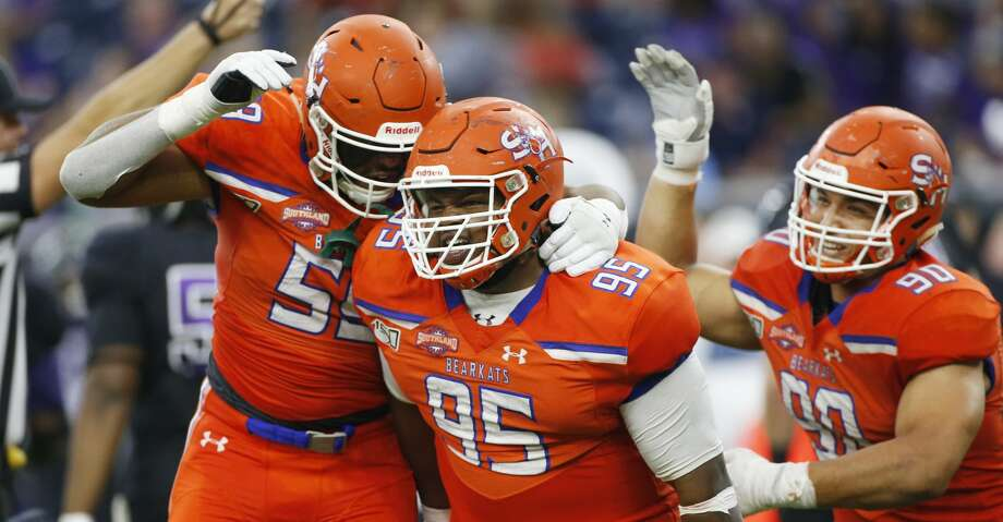 Sam Houston State Bearkats defensive lineman Joseph Wallace (95) is congratulated by his teammates after his quarterback sack caused a fumble in the fourth quarter of Battle of the Piney Woods at NRG Stadium against Stephen F. Austin on Saturday, Oct. 5, 2019. Sam Houston State won the game 31-20. Photo: Elizabeth Conley/Staff Photographer