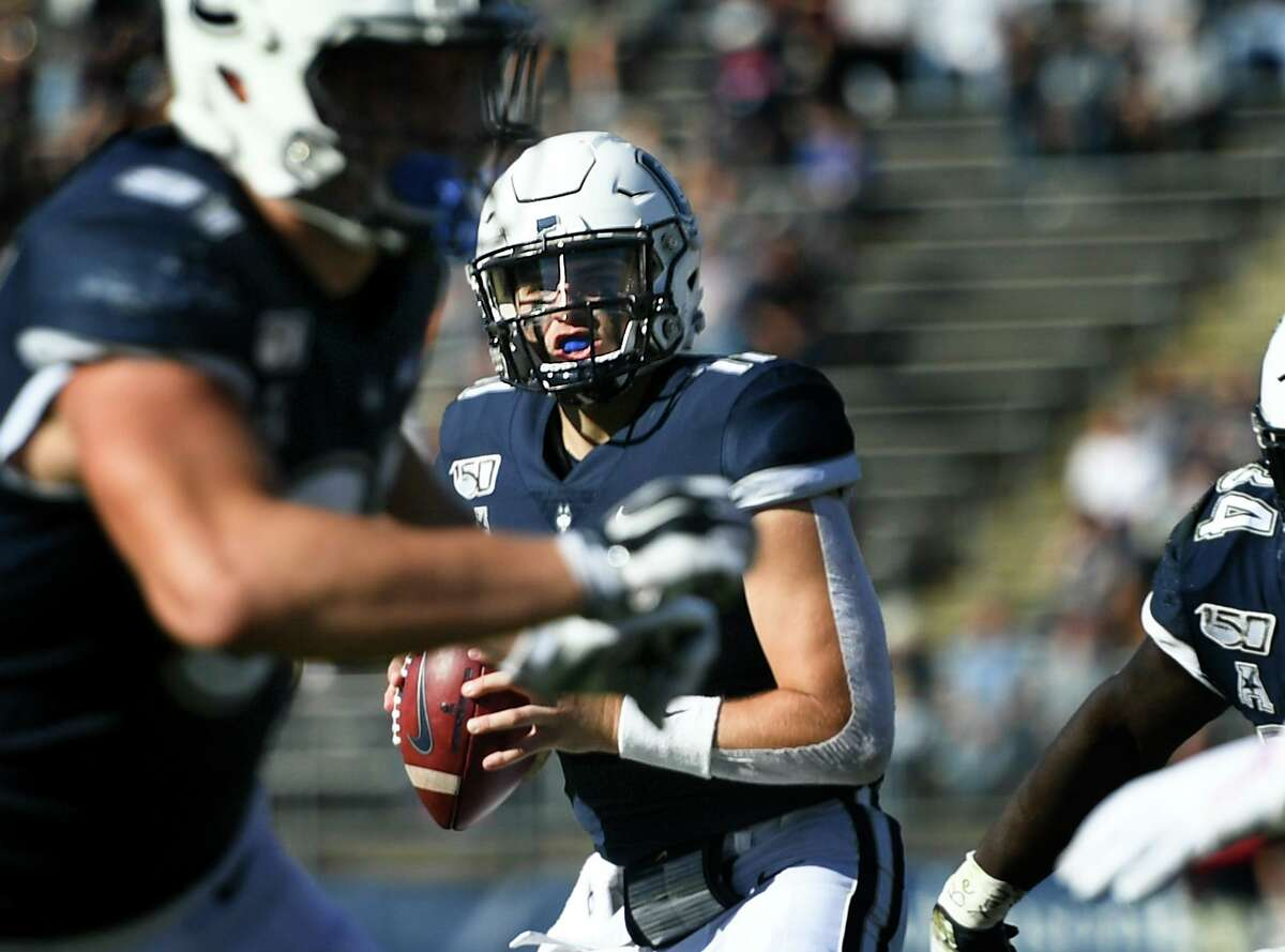 UConn quarterback Jack Zergiotis (11) sets to pass during the second half of an NCAA college football game against Houston on Saturday, Oct. 19, 2019, in East Hartford, Conn.