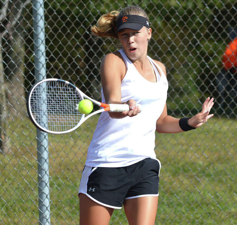 Edwardsville sophomore Hannah Colbert makes a forehand return on Saturday during the third-place doubles match at the Class 2A Edwardsville Sectional.