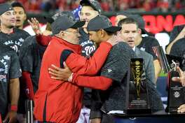 Washington Nationals owner Ted Lerner hugs manager Dave Martinez after they swept the St. Louis Cardinals during game four of the NLCS to advance to the World Series at Nationals Park.