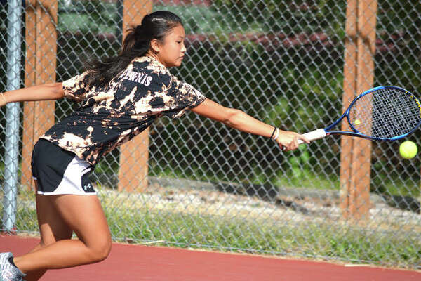Edwardsville freshman Chloe Koons reaches for a backhand shot on Saturday during the singles championship match at the Class 2A Edwardsville Sectional.