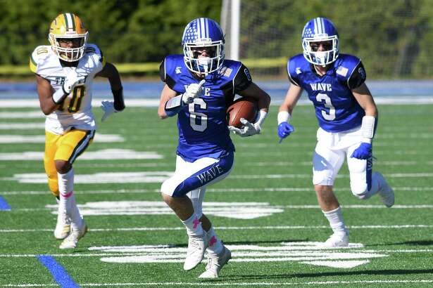 Darien's Michael Minicus (6) breaks free for a touchdown with Trinity Catholic/Wright Tech's Luigi Bernard (10) in pursuit during a football game at Darien High School on Saturday, Oct. 19, 2019.