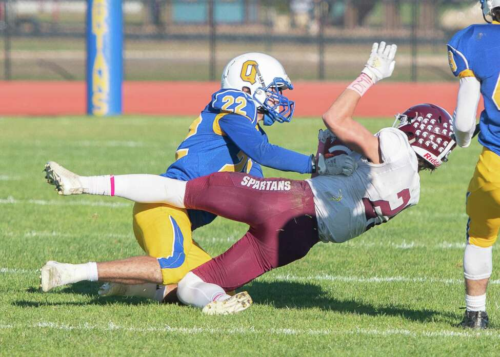 Queensbury corner back Patrick Morehouse tackles Burnt Hills wide receiver Logan Stubblebine on a punt return during the Class A Grasso Division title on Saturday, Oct. 19, 2019, in Queensbury, N.Y. (Jenn March, Special to the Times Union )