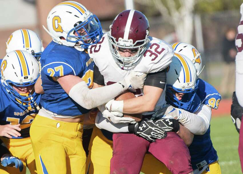 Queensbury defense tackles Burnt Hills running back Matthew Seidel during the Class A Grasso Division title on Saturday, Oct. 19, 2019, in Queensbury, N.Y. (Jenn March, Special to the Times Union )