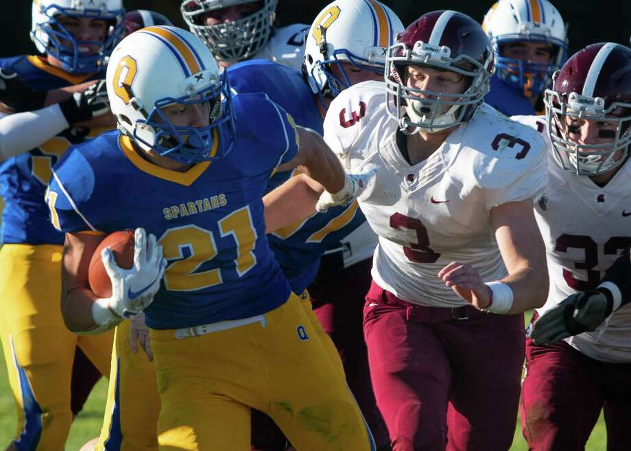 Queensbury running back Jason Rodriguez escapes Burnt Hills defense on a drive during the Class A Grasso Division title on Saturday, Oct. 19, 2019, in Queensbury, N.Y. (Jenn March, Special to the Times Union ) Photo: Jenn March, Jenn March Photography / © Jenn March 2018 © Albany Times Union 2018
